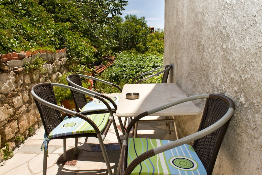 Small outdoor space with table and chairs